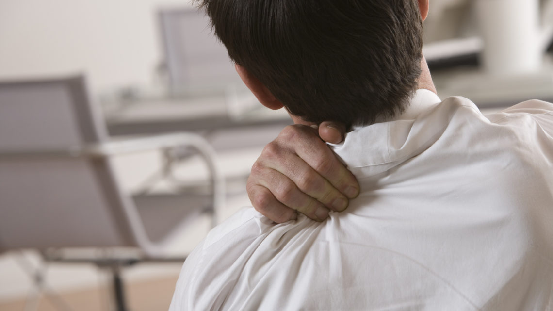 Businessman massaging shoulder