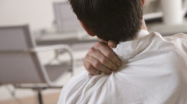 Businessman massaging shoulder