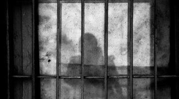 iron bars with prisoner shadaow