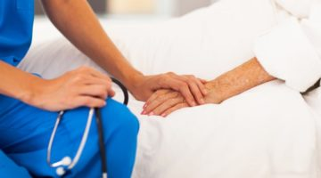 nurse holding hand of patient