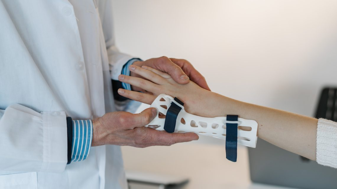 doctor putting a brace on someone's wrist