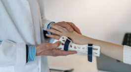 doctor putting a brace on someone's wrist